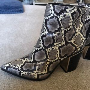 Circus by Sam Edleman snakeprint boots.